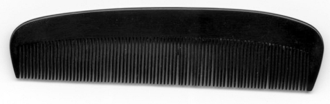 This comb was carried throughout Andy Daniels' mission behind enemy lines. It is not a normal comb, but a very special one made by a 'secret department (Magic)' of the SOE. If Andy Daniels, after being dropped behind enemy lines, were to become lost he would simply break open this comb and he would find a compass inside! (Source: Camp X Official)