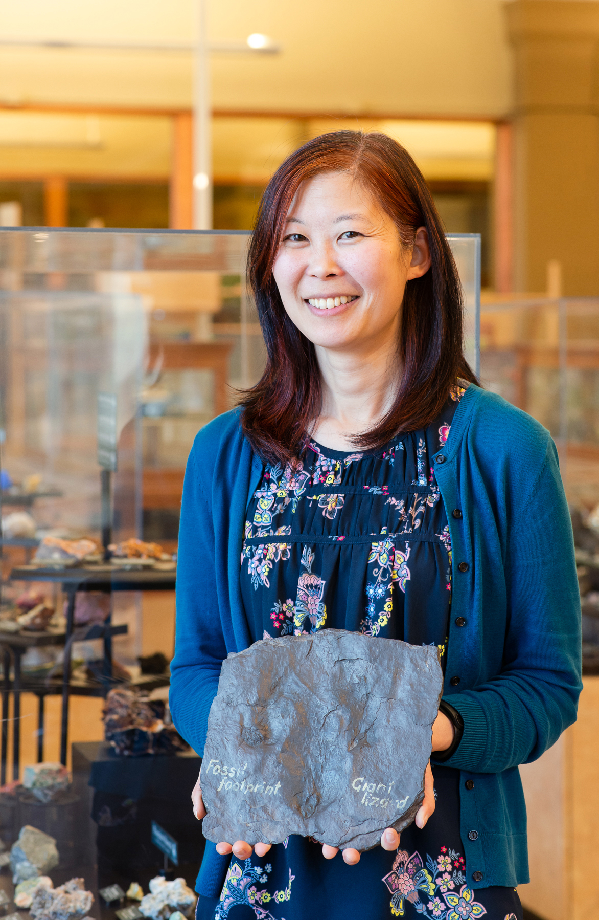 Linda Tsuji presenting a fossil at Miller Museum of Geology in Kingston, Ontario.